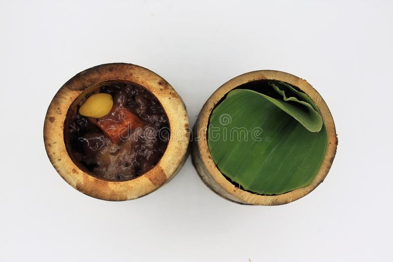 Glutinous rice roasted in bamboo joints royalty free stock photography