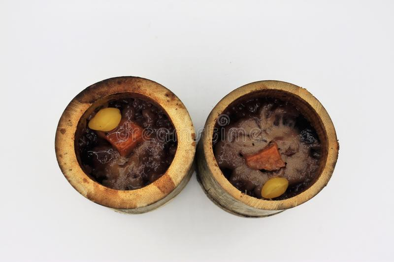 Glutinous rice roasted in bamboo joints royalty free stock photos