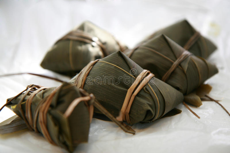 Glutinous rice tamale. A food Chinese people make in Duan Wu festival or the dragon boat festival. In the past they threw them into the river to prevent the stock image