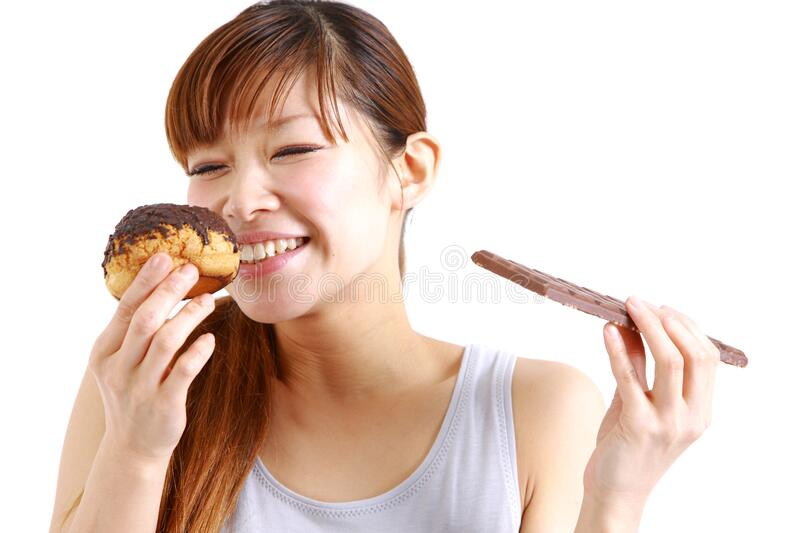 Gluttonous woman. Concept shot of young womans life style stock photography