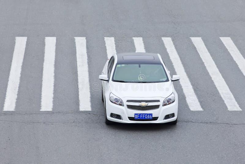 GM Chevrolet Cruze crossing a zebra path, Beijing, China royalty free stock photo