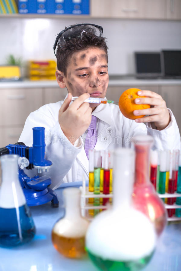 GMO experiment boy scientist injecting liquid. Mad gmo experimant in laboratory royalty free stock images