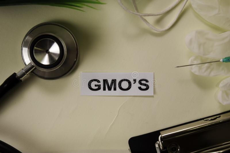 GMO`s with inspiration and healthcare/medical concept on desk background royalty free stock images