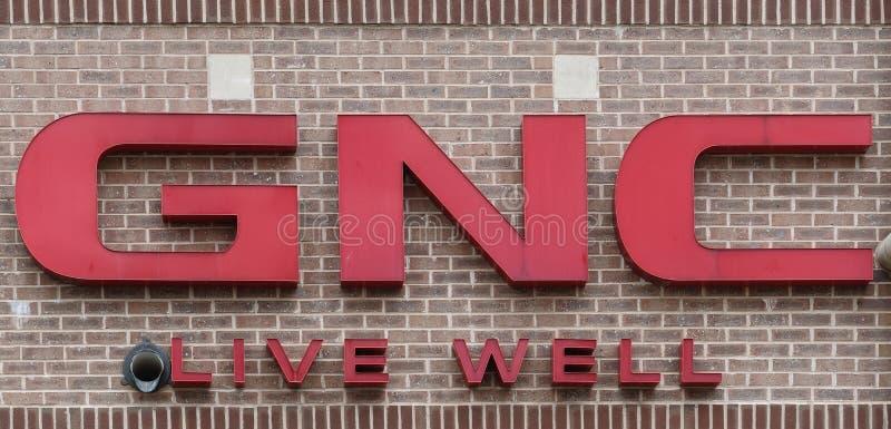GNC, o sinal de um varejista do saúde-e-bem-estar fotografia de stock