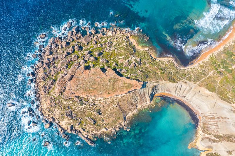 Gnejna and Ghajn Tuffieha bay on Malta island. Aerial view View from the top exactly of the coastlinescenic sliffs near the. Mediterranean turquoise water sea royalty free stock photography
