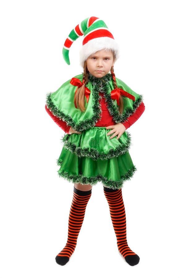 Gniewna mała dziewczynka - Santa ` s elf na bielu zdjęcie royalty free