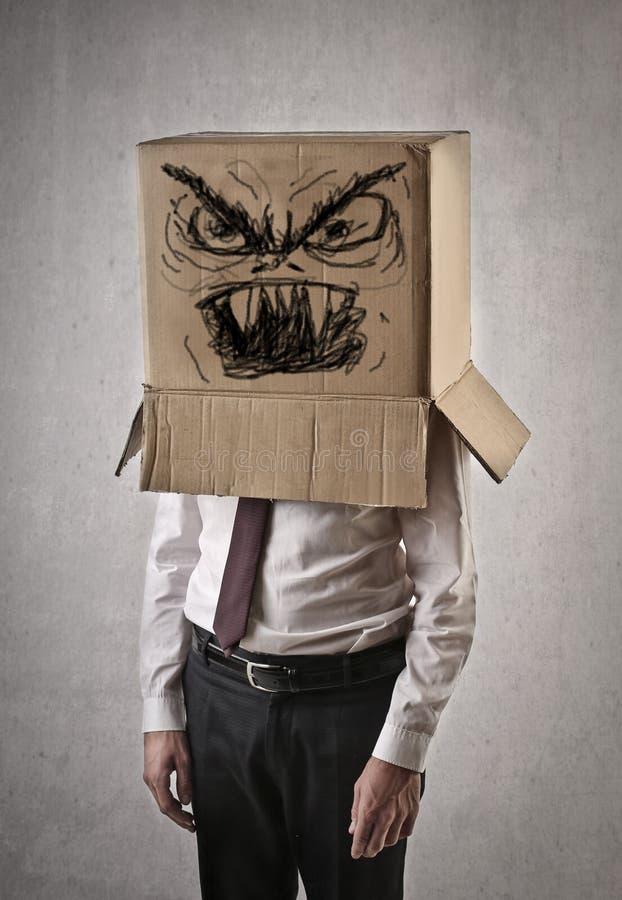 Gniewny biznesmen z pudełkiem na jego głowie zdjęcie royalty free