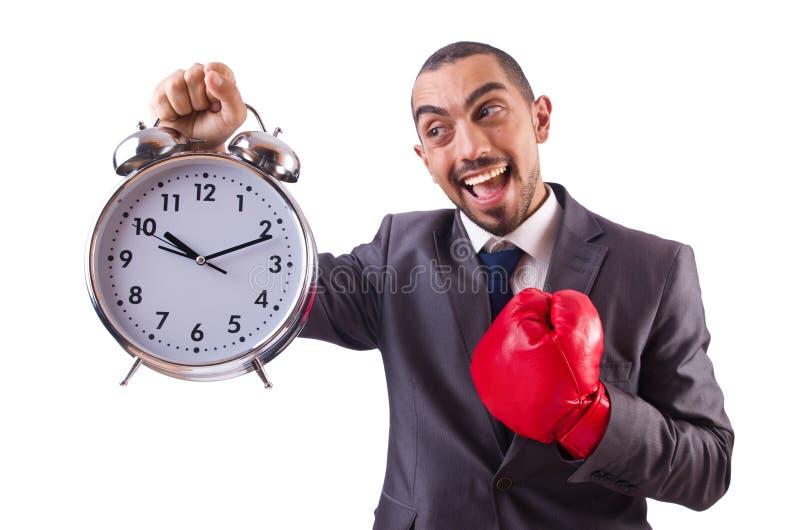 Gniewny biznesmena ciupnięcia zegar odizolowywający fotografia stock