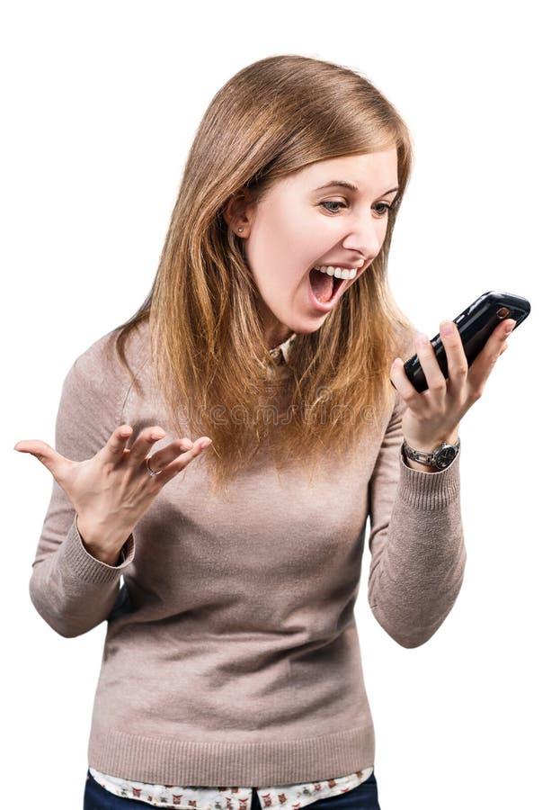 Gniewny bizneswoman krzyczy na smartphone fotografia royalty free