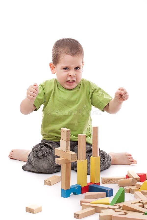 gniewny bloków chłopiec whit zdjęcie royalty free