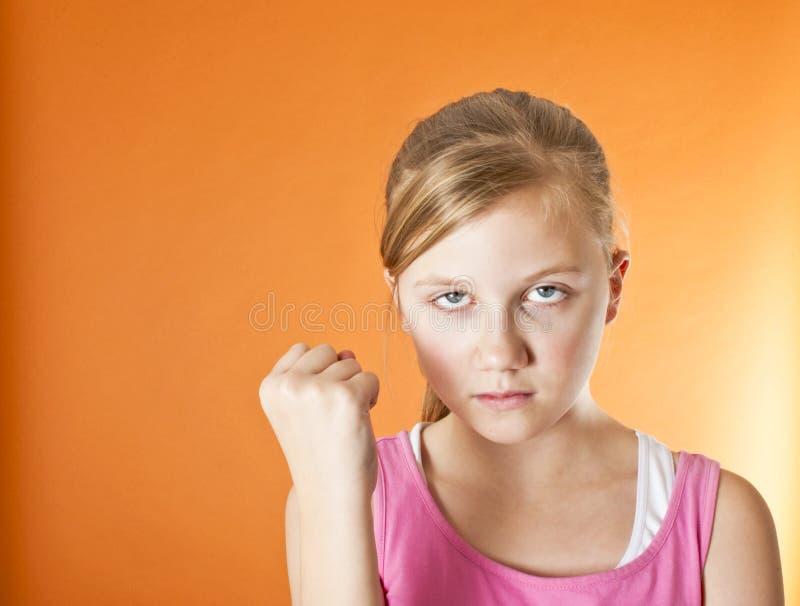 Gniewny dziecko z pięścią podnoszącą zdjęcia stock