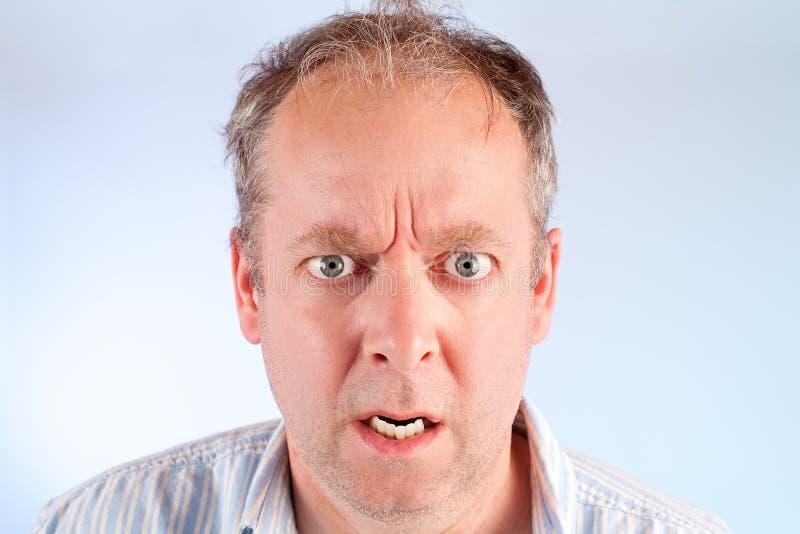 gniewny mężczyzna coś obrazy royalty free