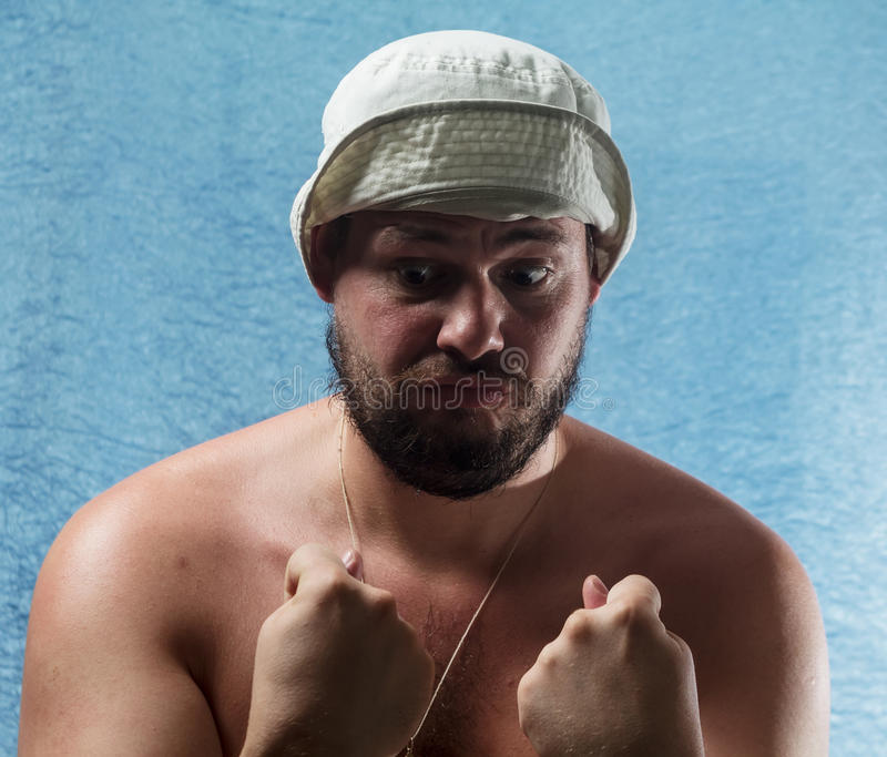Gniewny mężczyzna obraca emocjonalnie nieodpowiedniego figa palec obrazy stock