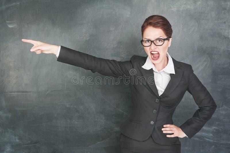 Gniewny nauczyciel wskazuje out obrazy royalty free