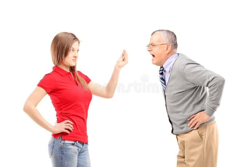 Gniewny ojciec krzyczy przy jego córką zdjęcia stock