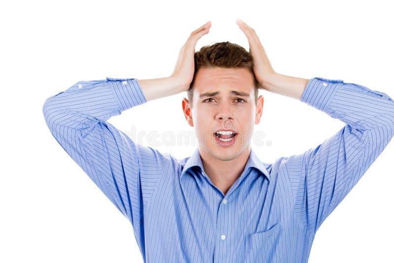 Gniewny, sfrustowany mężczyzna, ciągnie jego włosy out fotografia stock