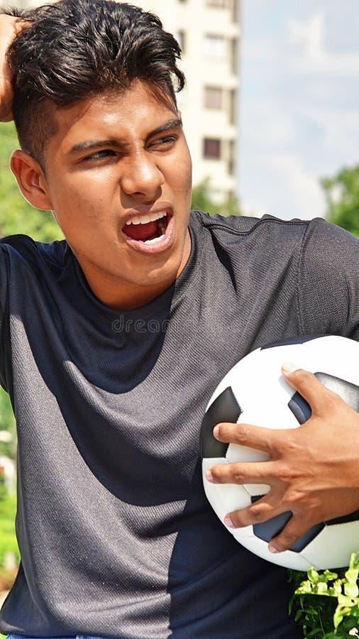 Gniewny Sportowy Męski gracz piłki nożnej obraz stock