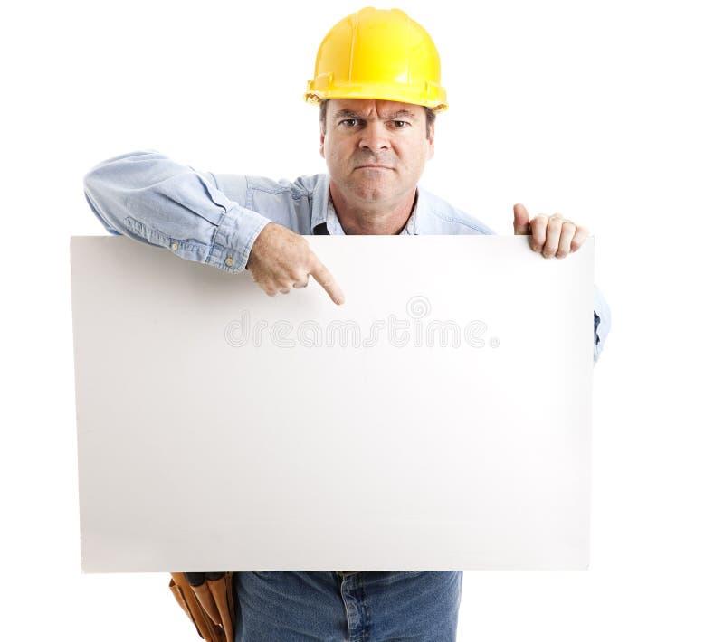 gniewny szyldowy pracownik zdjęcie stock