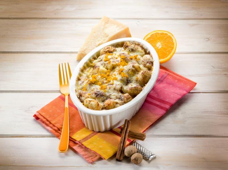 Gnocchi gratin with nutmeg stock photos