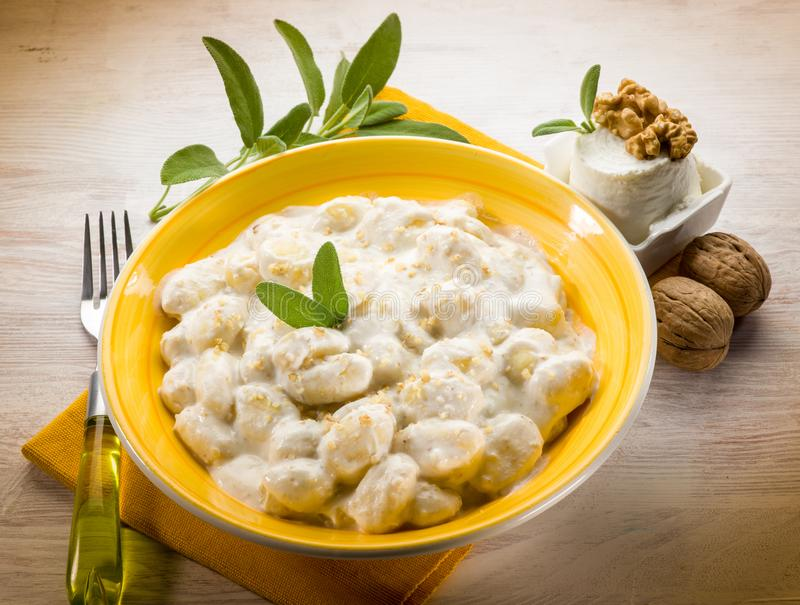 Gnocchi with ricotta and nuts stock photos