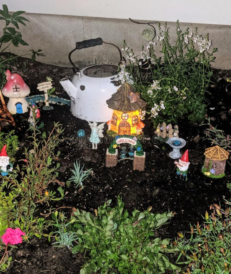 Gnome and Fairy Garden at night royalty free stock photo