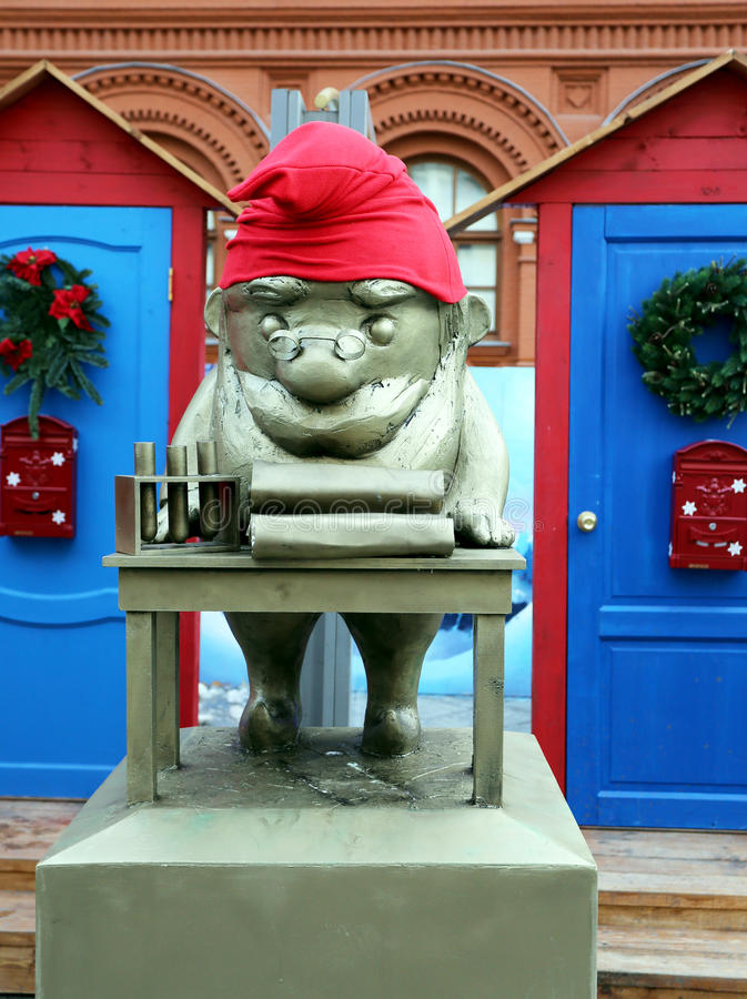 Gnome in a red cap. Photographed close-up stock photos