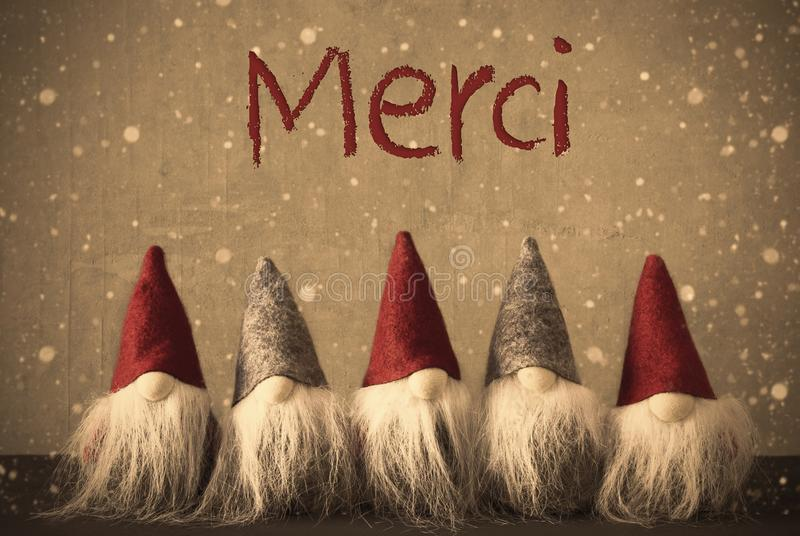 Christmas Gnomes, Snowflakes, Merci Means Thank You. Gnomes With French Text Merci Means Thank You. Background With Snowflakes And Filter With Retro Style stock photography