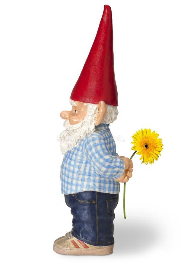 Gnomo del jardín con la flor imágenes de archivo libres de regalías