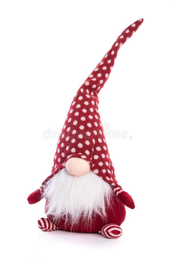 Gnomo escandinavo no brinquedo decorativo do Natal do chapéu vermelho isolado fotos de stock royalty free
