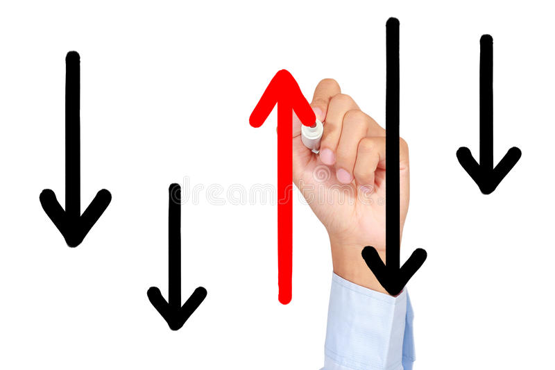 Go against the flow. A man is drawing red arrow line against the flow royalty free stock photography