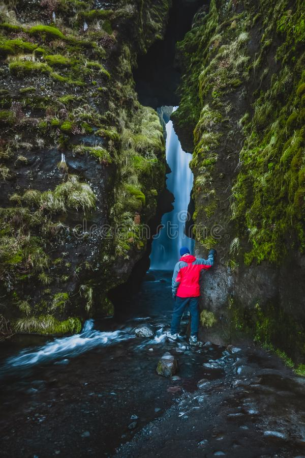 Hikers exploring a waterfall in Iceland royalty free stock photos