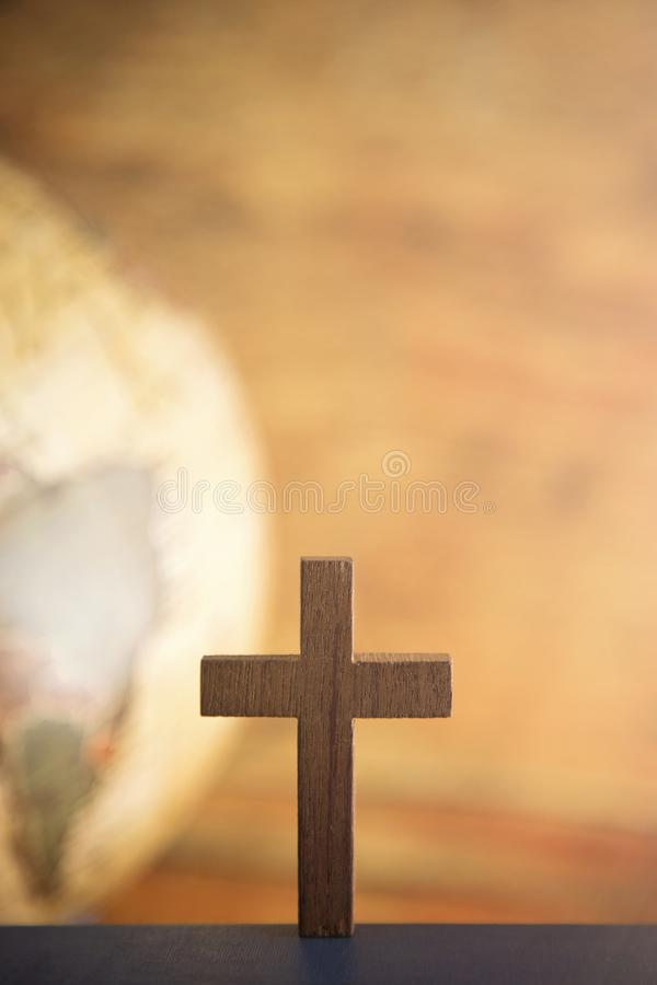 Go Into All the World and Tell the Gospel to All Creation. A Cross and a Globe in the Background stock photography