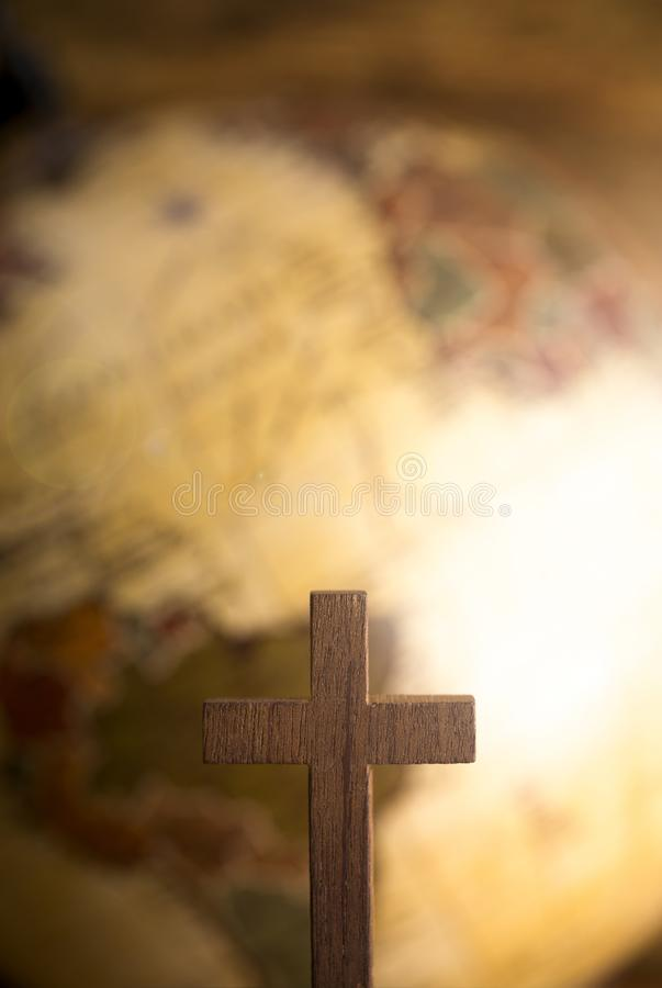 Go Into All the World and Tell the Gospel to All Creation. A cross and a Globe in the Background royalty free stock photo