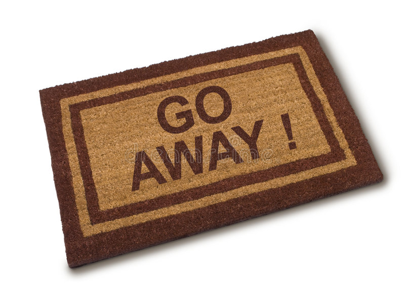 Go Away Unwanted Not Wanted. A welcome mat that says go away stock photo