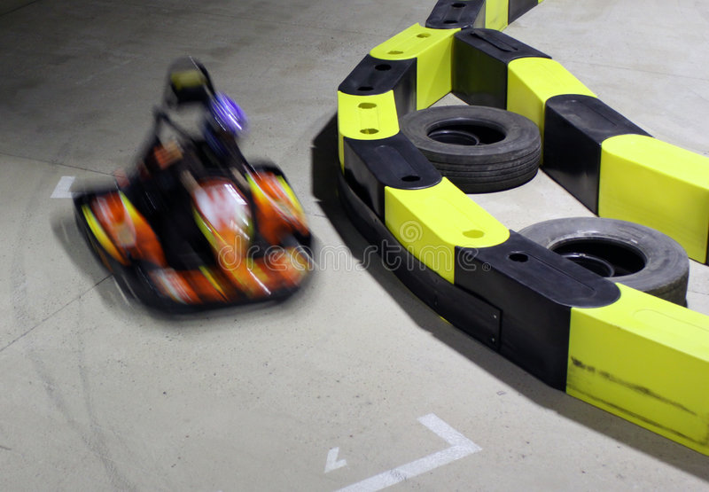 Go-cart. Auto racing track with one motion blurred go-cart stock photos