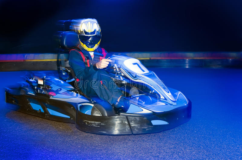 Go-Cart driver. During a lap on an indoor carting circuit royalty free stock photography