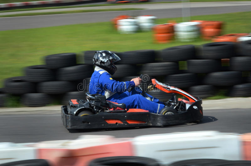 Go cart race. Go kart going fast out of the corner royalty free stock images