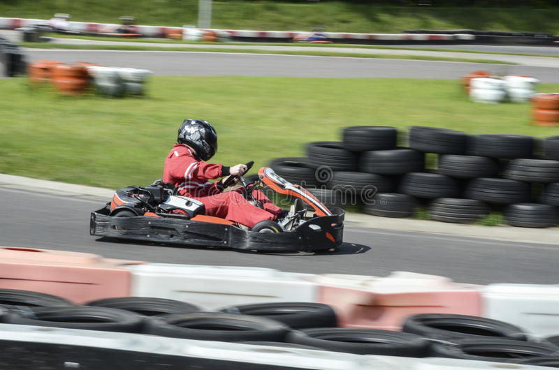Go cart racer. Go kart going fast out of the corner stock image