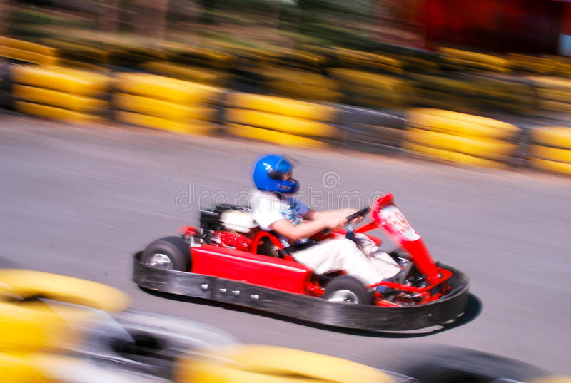 Go-cart racing. Go-cart racer ride fast royalty free stock images