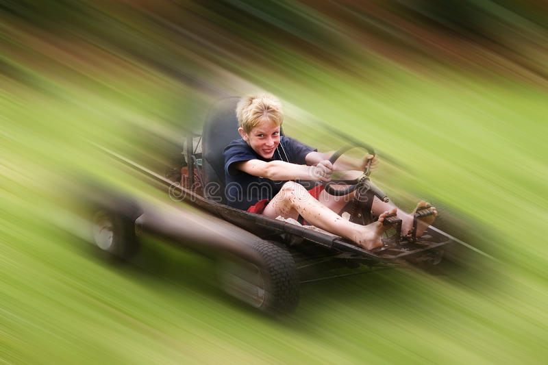 Go-cart teen. Young teenager having fun in a go-cart at high speed royalty free stock photography