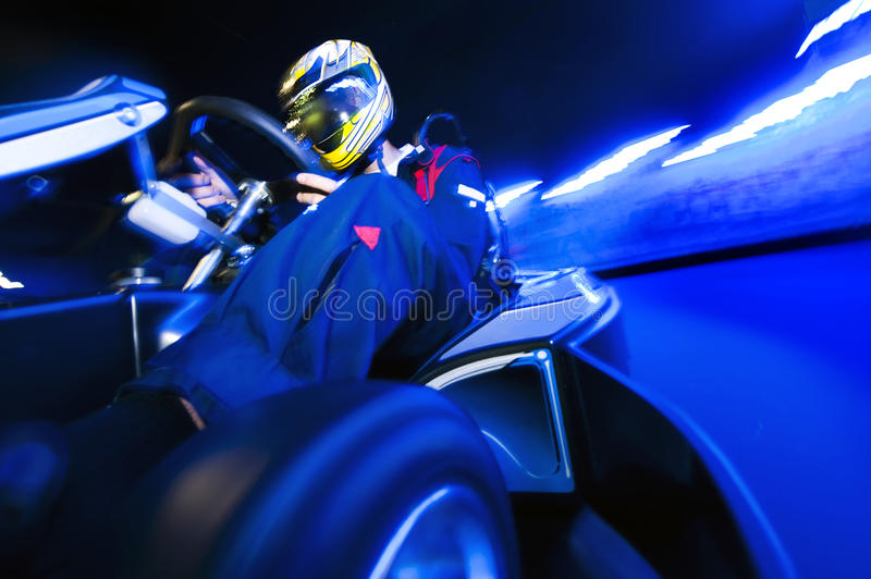 Go-Carting. Go-Cart racing driver taking the apex on an indoor circuit royalty free stock photos