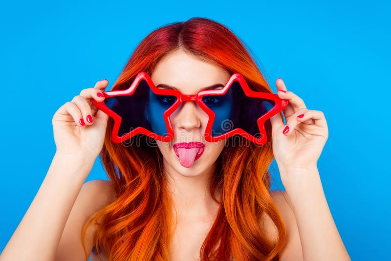 Go crazy! Young cheerful foxy with big funny star glasses and to royalty free stock images