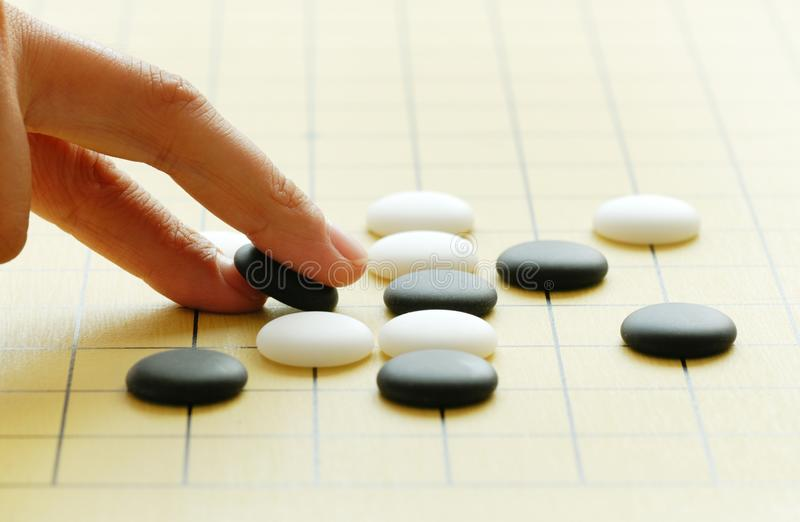Go game. Playing the game of go stock photo