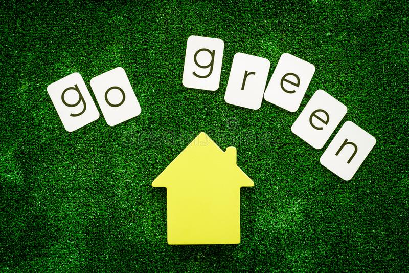 Go green copy and house on green texture background top view.  royalty free stock photos