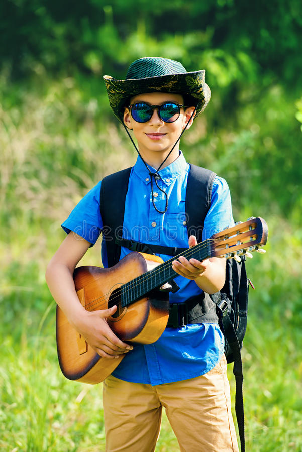 Go hiking with guitar stock image