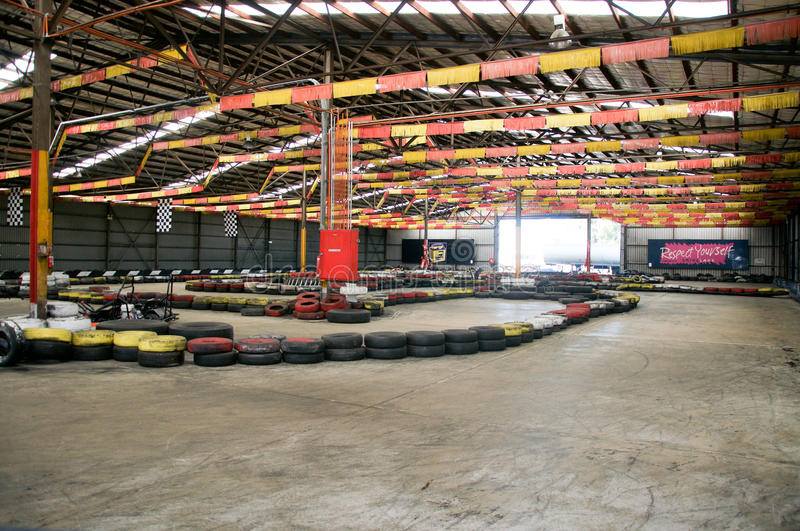 Go Kart: Colourful Racing Track. O'CONNOR,WA,AUSTRALIA-MARCH 5,2016: Indoor Kart Hire in O'Connor, Western Australia with go carts, flag decor and tire boundary stock photos