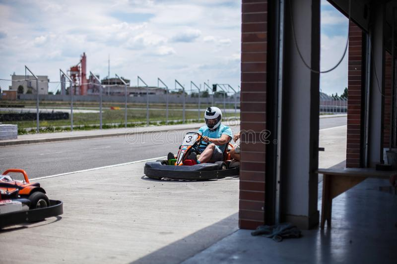 Go kart speed, indoor opposition race. Karting competition or racing cars riding family outdoor activities stock photos