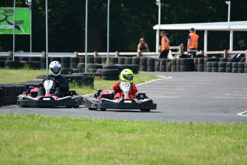 Go Karting Race. Amateur go kart racing. All fighting for the best position on the bend of the race circuit royalty free stock images
