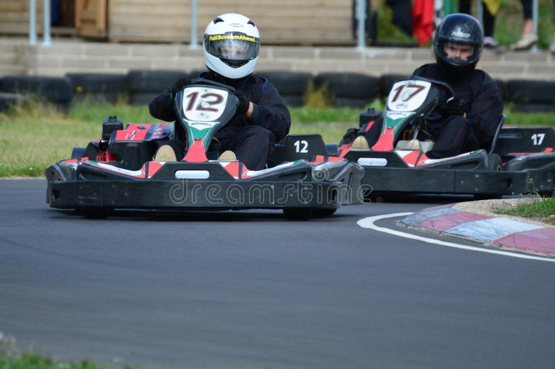 Go Karting Race. Amateur go kart racing. All fighting for the best position on the bend of the race circuit stock photography