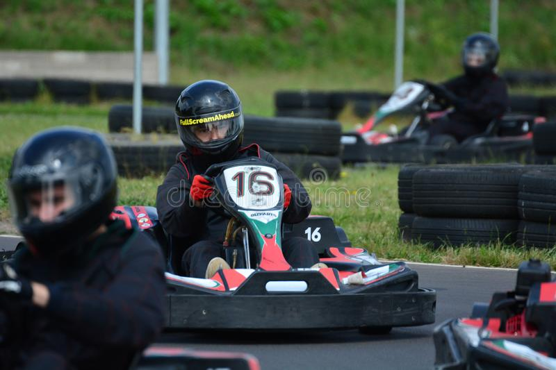 Go Karting Race. Amateur go kart racing. All fighting for the best position on the bend of the race circuit royalty free stock photography